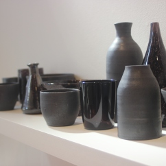 Emily Siddell and Stephen Bradbourne, Still Life (2015) 73 black vessels, blown glass and wheel thrown clay, various sizes.